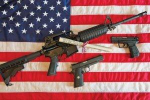 american_flag_and_gun_450