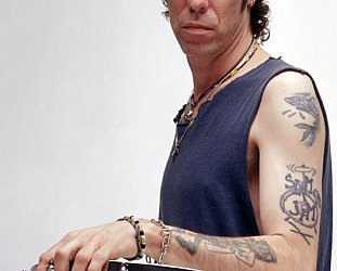 SLIM JIM PHANTOM OF THE STRAY CATS INTERVIEWED, AND CONCERT REVIEW. (2009) Still strutting