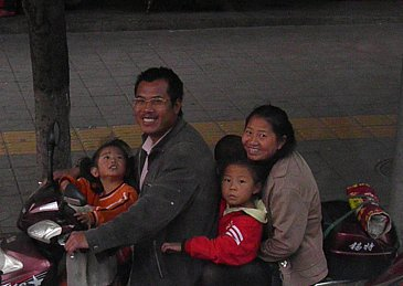 Kunming, China: People, people who need people . . .